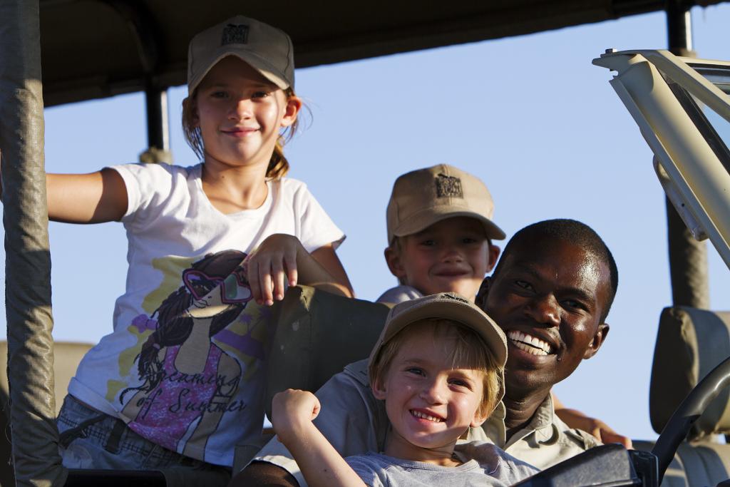 Made in Africa Tours & Safaris - Botswana Family Lodge Safari - Children with Safari Guide