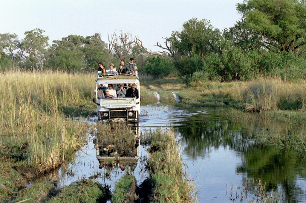 water crossing with safari vehicle reflected1